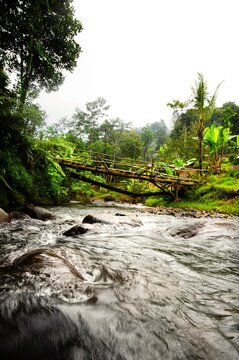 Beautiful scenery of a river flowing through a village near the Mount Gede, West Java, Indonesia