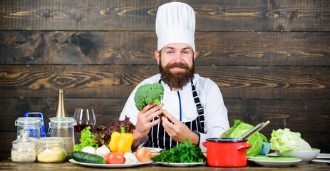 This is my favorite food. Vegetarian salad with fresh vegetables. Dieting organic food. Cuisine culinary. Vitamin. Happy bearded man. chef recipe. Healthy food cooking. Mature hipster with beard
