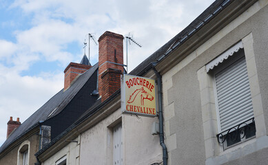 Arras, France 08-23-2014 sign of a horse butcher with typical french small village architecture background