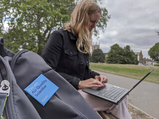 Dyson design engineer Rowley examines data on her laptop on Clapham Common, London