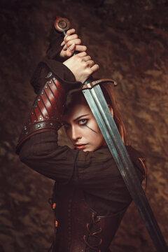 Beautiful woman fighting with sword