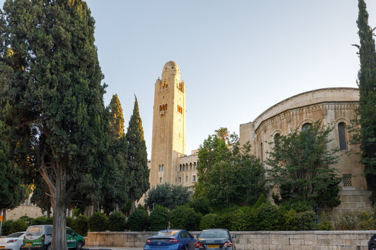 The Jerusalem International YMCA and International Seventh-day Adventist Church buildings are in the light of the rays of the setting sun in Jerusalem, Israel