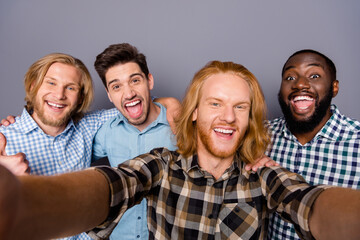 Close up photo of excited energetic four man enjoy rejoice bachelor party event make selfie wear...