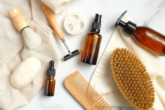 Set of bath accessories and shaving tools for men skin care. Flat lay, top view. SPA natural organic cosmetic products, eco-friendly bathroom items.