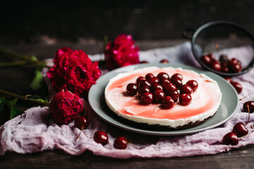 Fresh cheesecake with cherries on the rustic background. Selective focus. Shallow depth of field.
