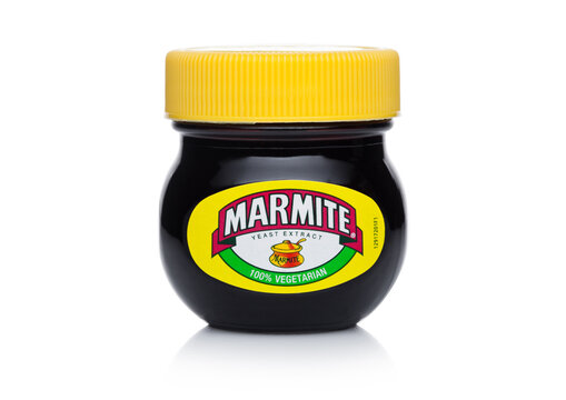 LONDON, UK - JANUARY 10, 2018: Glass jar of Marmite yeast extract on white. The product is made by the Unilever company.