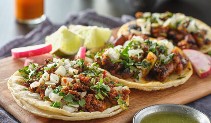Wall Mural - mexican street tacos with carne asada on corn tortillas platter