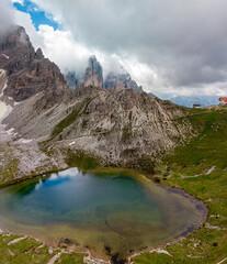 Aerial view of the laghi dei Piani and the Paterno mountain. In the background the Tre Cime di Lavaredo, Drei Zinnen. Sexten Dolomites of northeastern Italy; Alps