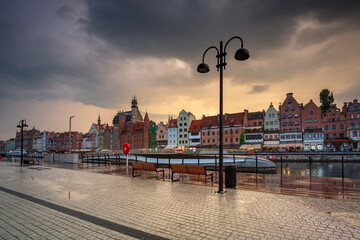Old town in Gdansk with historical port crane over Motlawa river at sunset, Poland.