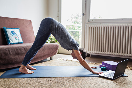 Yoga teacher giving online video classes from home on the internet