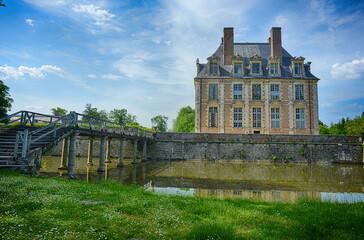 Le Ferté Saint Aubin, France, historical castle in the loire valley with old wooden bridge and garden view