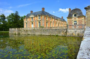 La Ferté Saint Aubin, France historical castle site buildings and the moat full of water lilies