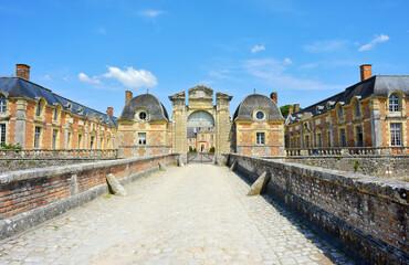 La Ferté Saint Aubin, France, historical castle buildings with old gate and typical french architecture