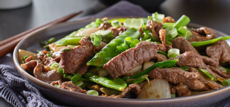 chinese beef and snowpeas stirfry on plate