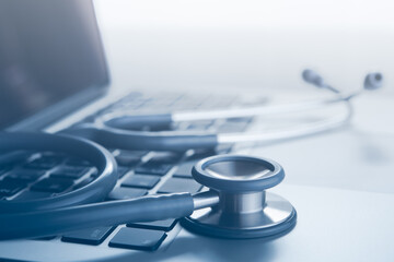 Stethoscope on laptop computer for medical technology telemedicine and medical online concept