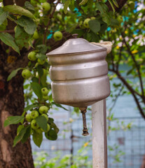 Photo sur Toile Doux monstres an old russian metal washstand in summer apple garden