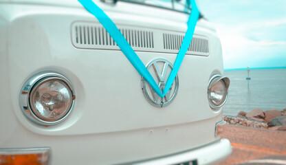 Southend on Sea, England - September 18, 2016: Volkswagen VW Badge on a camper van dressed in a blue wedding ribbon.