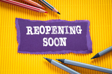 Reopening soon. Business concept. Text on torn, purple paper