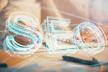 Double exposure of woman's hands making notes with SEO icon. Concept of Search engine optimization