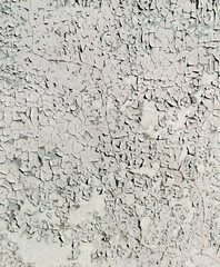 Cracked white paint on metal as an abstract background.