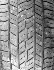 Tread on a car wheel as an abstract background.