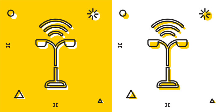 Black Smart street light system icon isolated on yellow and white background. Internet of things concept with wireless connection. Random dynamic shapes. Vector.