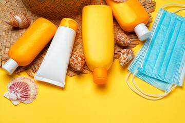 Sunscreen cream and protective mask. Coronavirus summer concept