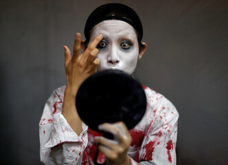 Actor Ayaka Imaide prepares a zombie makeup before her performance at a drive-in haunted house show by Kowagarasetai, for people inside a car in order to maintain social distancing amid the spread of the coronavirus disease (COVID-19), in