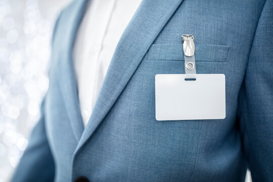 Blank security name tag on businessman suit pocket