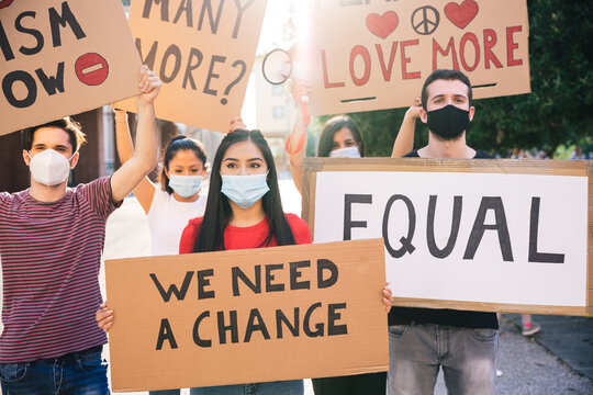 Group of young multiethnic demonstrators in a road - People protesting for equality and for stop the racism - Millennial wearing face mask avoid the infection from Coronavirus, Covid-19