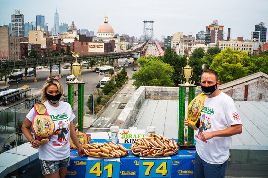 Current world record holder Chestnut and current women's champion Sudo pose for a picture during the official weigh-in ceremony for the Nathan's Famous Fourth of July International Hot Dog Eating Contest, in New York