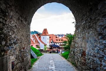 Famous Cesky Krumlov through stone archway