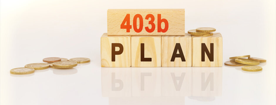 On a white reflective surface are coins and wooden cubes with the inscription - 403b Plan