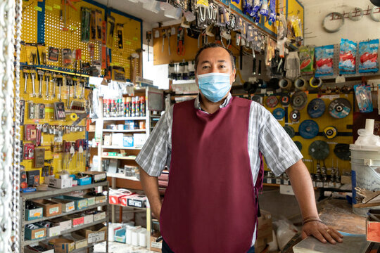 Entrepreneur in his business working with face masks