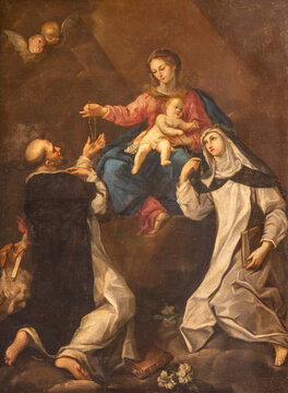 RAVENNA, ITALY - JANUARY 28, 2020: The painting of Madonna with the St. Dominic and Catherine of Siena in church Basilica di Santa Maria del Porto by Andrea Barbiani from 18. cent.