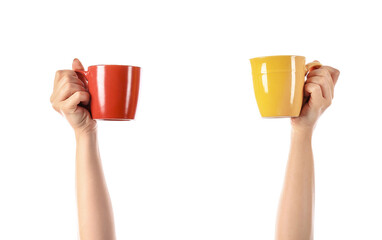 Papiers peints Cafe Hands with cups of hot coffee on white background