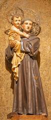 BARCELONA, SPAIN - MARCH 3, 2020: The carved polychrome statue of St. Anthony of Pauda in the church Iglesia Santa Maria de Gracia de Jesus.