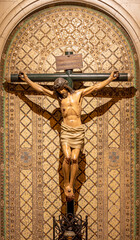 BARCELONA, SPAIN - MARCH 3, 2020: The detail of carved crucifixion in the chruch Iglesia Santa Maria de Gracia de Jesus from 19. cent..