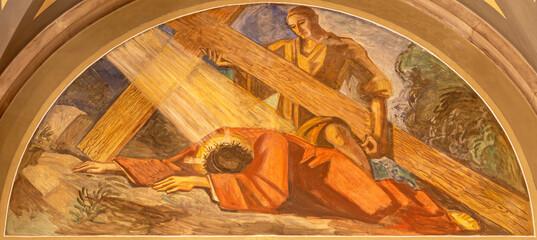 BARCELONA, SPAIN - MARCH 3, 2020: The fresco of Jesus fall under the cross in the church Santuario Nuestra Senora del Sagrado Corazon by Francesc Labarta (1960).