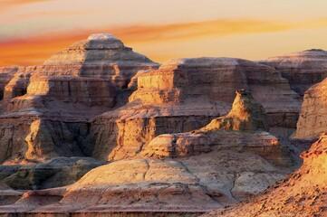 Foto op Plexiglas Diepbruine Yadan landform in Xinjiang at sunset