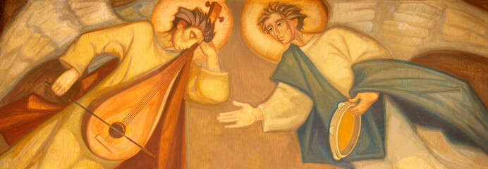BARCELONA, SPAIN - MARCH 3, 2020: The painting of angels with the music instruments in the church Santuario Nuestra Senora del Sagrado Corazon by Navarro Perez-Dolz (1989).
