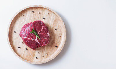 Raw meat, beef steak, on wooden board, on white background