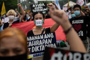 Filipinos protest after President Rodrigo Duterte approved anti-terror bill