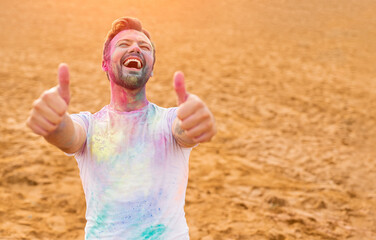 Excited man approving paint festival