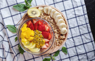 Bowl of Mixed Healthy Fruits Salad with Granola. Top View