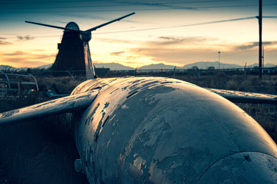 Old military airfare aircraft in a junkyard during sunset in New Mexico