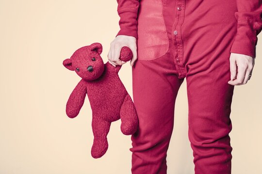 Pink teddy bear with pink man