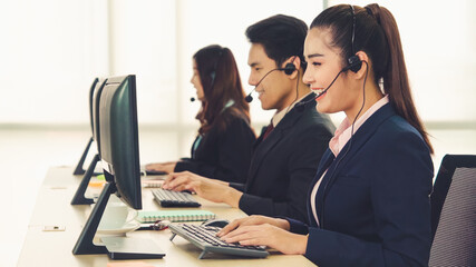 Business people wearing headset working in office to support remote customer or colleague. Call...
