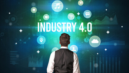 Rear view of a businessman with INDUSTRY 4.0 inscription, modern technology concept