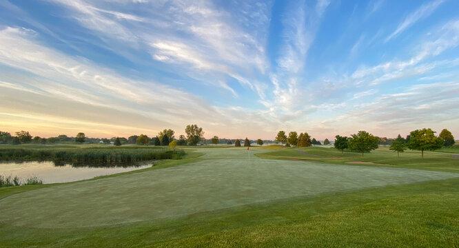 sunrise golf course wispy clouds blue sky